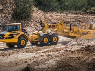 mini excavator on hill